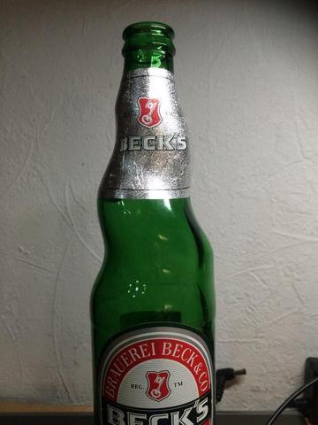 ....... - (Flasche, besonders, selten)