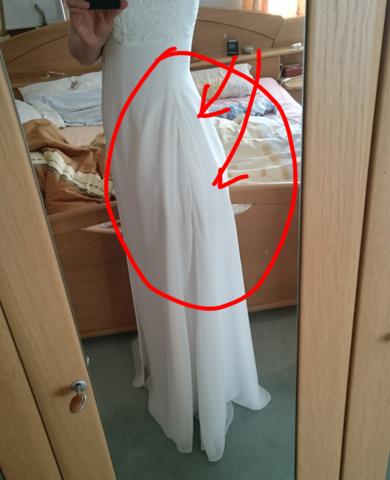 Seiten des Kleides nach der Änderung durch die Schneiderin des Brautladens  - (Recht, Brautkleid, Aenderungsschneiderei)
