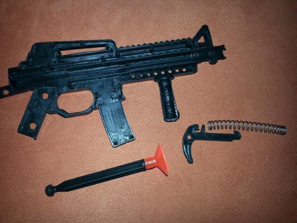 einzelnen teile ( und das orangene ist die monition) - (Freizeit, reparieren Spielzeug Pistole, volksfest spielzeugpistole)