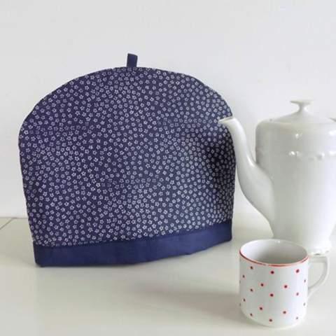 Weiß jemand, wie dieses Zubehör für eine Teekanne heißt (Foto)?