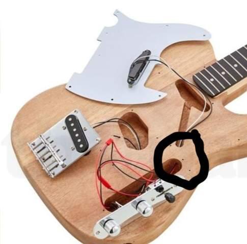 Wie Loch in Gitarre bohren?