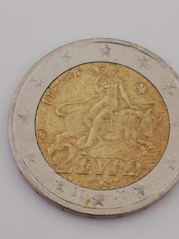 Wie viel ist diese Münze wert oder kennt sie wer?