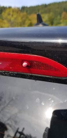 Wozu ist dieser Nippel am hinteren Bremslicht?
